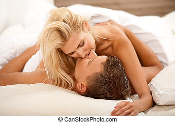 couple during sexual intercourse on the bed