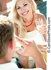 girl having fun - white wine on a date - woman having white...