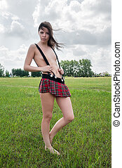 Sexy nude woman stands in field - Young attractive woman...
