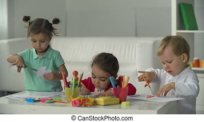 Creative Childhood - Three adorable babies doing handicrafts