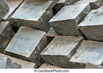 Granite paving sets stacked ready for use