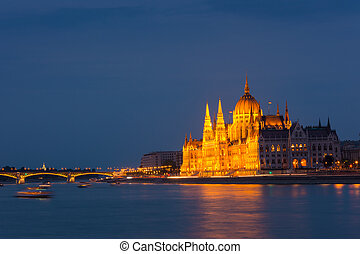 Parliament building Budapest at twilight over the river Danube
