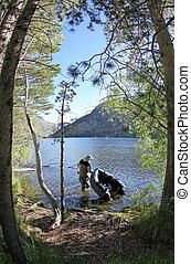 Pontoon Fisherman in a Lake - Pontoon Fisherman in a Sierra...