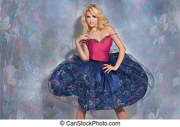 Fashionable blonde lady posing in floral skirt - Fashionable...