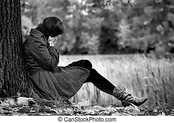 Autumn despair - An image of desperate women in autumn park