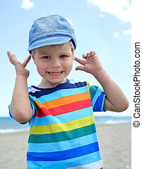 Small boy holds his hands over ears not to hear - Portrait...