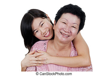 Mother & Daughter - Happy Asian Family. Daughter hugging her...