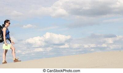 girl standing in the desert