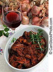 Boeuf bourguignonne bowl vertical - A serving bowl of boeuf...