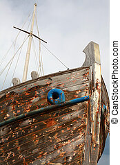 Abandoned wooden ship - The paint-stripped remains of a...
