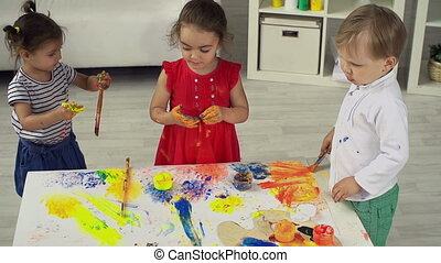 Free Play - Three little artists enjoying their messy...