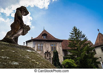 Castle in Meersburg, a small statue in the foreground.