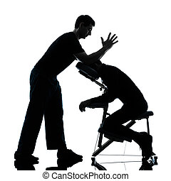 back massage therapy with chair silhouette - two men...