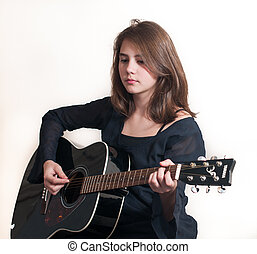 Teen girl with acoustic guitar - Young brunette teen girl...