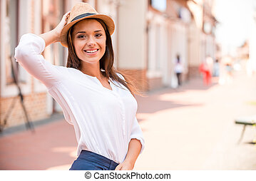 Trendy beauty Beautiful young woman adjusting her hat and...