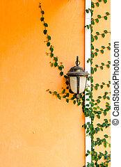 Lantern on a yellow wall
