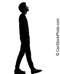 handsome african young man walking looking up silhouette