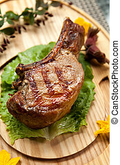 barbecued steak - juicy piece of grilled steak on a barbecue...