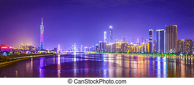 Guangzhou, China city skyline panorama over the Pearl River