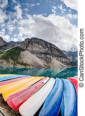 Kayaks on Moraine Lake in the Canadian Rockies