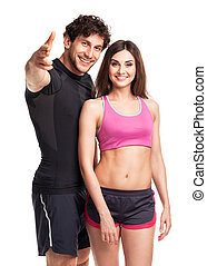 Athletic man and woman after fitness exercise on the white...