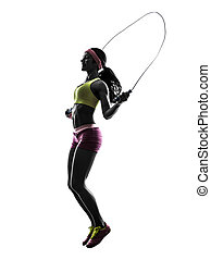 woman exercising fitness jumping rope silhouette - one woman...