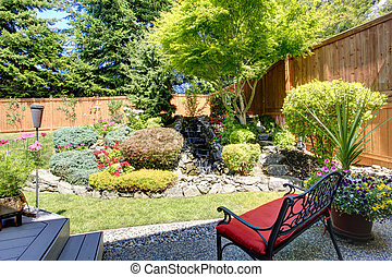 Beautiful landscape design for backyard garden with small...