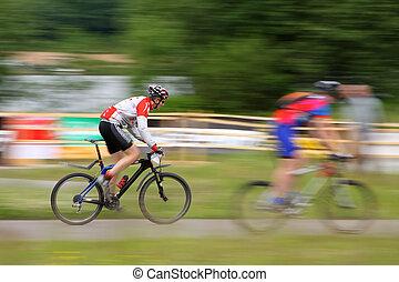 Mountain Biker in race - The Mountain Biker in race coross...