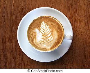 Cup of Frothy Coffee - Cup of coffee latte with leaf design...