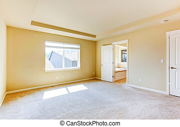 Empty master bedroom with bathroom