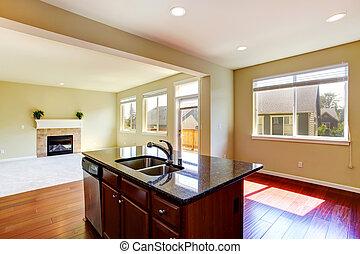 Modern kitchen island with granite top.