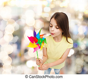smiling child with colorful windmill toy - education,...