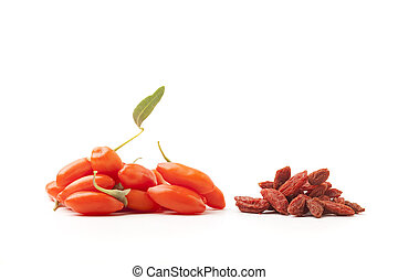 fresh and dry goji berry - piles of fresh and dry goji berry...