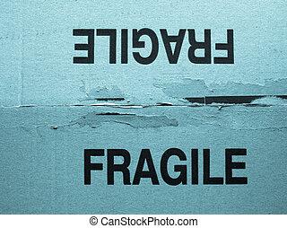 Fragile - Detail of a fragile corrugated cardboard packet -...