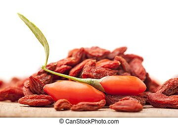 fresh and dry goji berry - pile of dry and fresh goji berry...