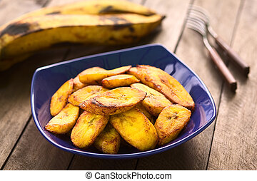 Fried Plantain Slices - Fried slices of the ripe plantain in...