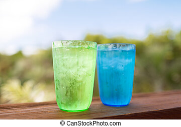 close up of two glasses with cold water - summer, drinks and...