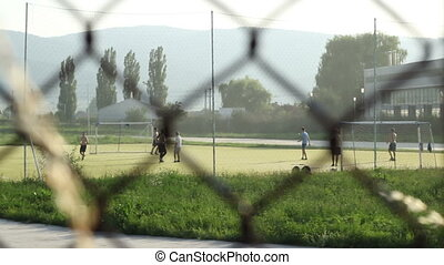 Playing Football in Neighborhood - Kids playing football in...