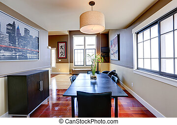 Classic dining room with ivory and brown wall trim