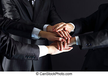 businesspeople putting their hands - business people putting...