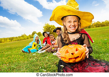 Wicked girl in witch dress with Halloween pumpkin - Wicked...