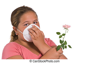 Allergic - A young girl holding a flower while she wears a...