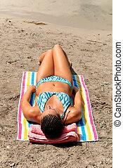 Woman bikini beach sunbathing - Young woman in bikini...