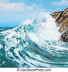 Crashing Wave - A wave crashing on the rocky shore at...