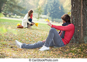 Autumn relaxing - Young mariage during autumn relaxing in...