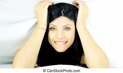 Woman getting out sheets smiling