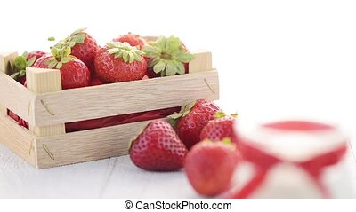 Strawberries and yoghurt dessert on white wooden table