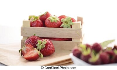 Strawberries and raspberries - Beautiful ripe fruit sitting...