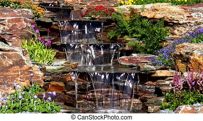 Garden water cascade tilt down - Tilt down of water stream...