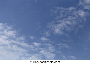 blue sky and clouds on bright day.